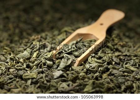 Tea leaves background/ green tea/  wooden scoop/ - stock photo