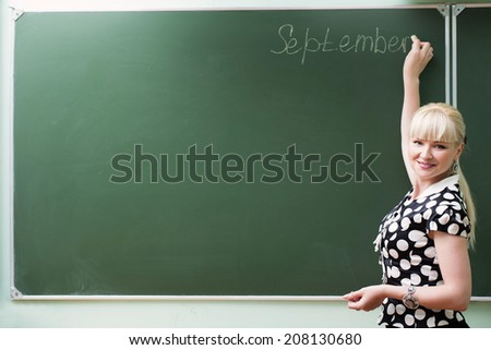 teacher at the blackboard - stock photo