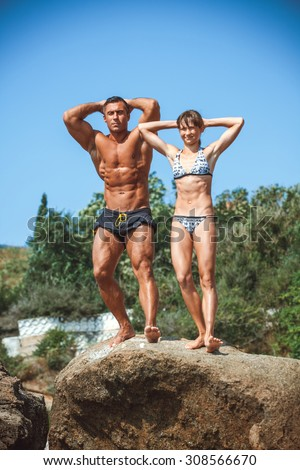 teacher on fitness with the pupil on a beach - stock photo