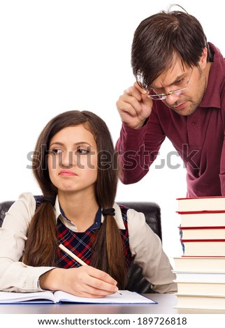 Teacher standing next to bored student  looking into his homework  isolated over white background - stock photo