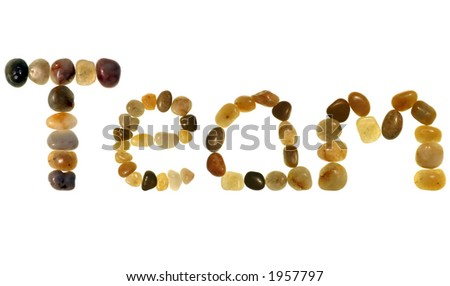"""Team� in colored pebbles on an isolated white background"