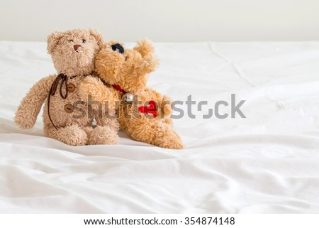 teddy bear and  brown dog  are friends ,love mode  - stock photo
