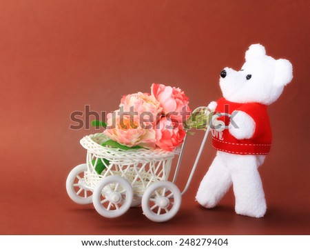 Teddy bear toy flower cart for an anniversary or Valentines celebration.  - stock photo