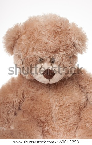 teddy bear wearing glasses, isolated on white background