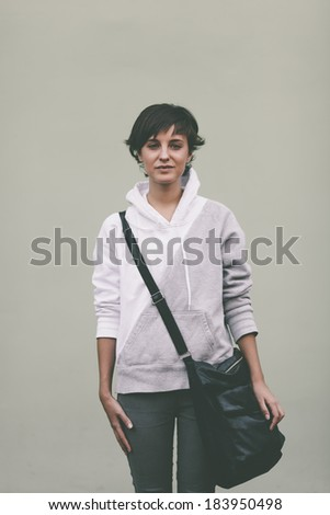 teen with black bag, soft natural light ,selective focus on face - stock photo