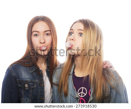 teenage girs  blows big bubble from bubble gum, isolated on white - stock photo