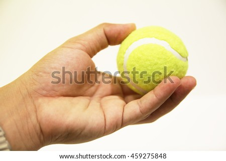 Tennis ball in hand