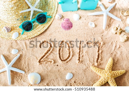 2017 text in the sand with beach accessories