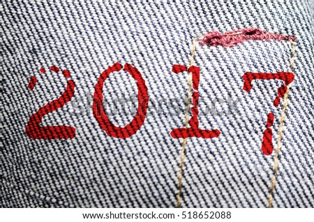 2017 text with jeans fabric texture Background.