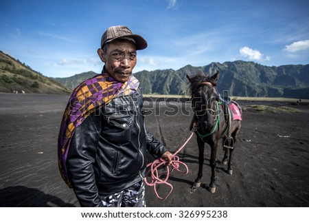 3th April 2014 at Bromo volcano indonesia : unidentifed man with a horse at Bromo volcano in Indonesia