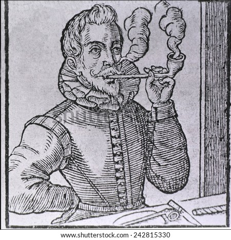 16th century Dutchman smoking a long-stemmed pipe, with another pipe and roll of tobacco on the table. 1595 wood engraving.