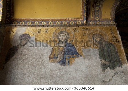 13th century Mosaic of Jesus Christ flanked by the Virgin Mary and John the Baptist in the Hagia Sophia in Istanbul, Turkey - stock photo