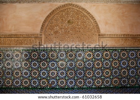 16th-century theological school in Marrakesh, morocco. Originally built in the 14th century, Sultan Abdullah el Ghallib added details in the cedar, stucco plasterwork and mosaics - stock photo