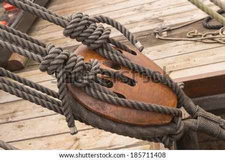 17th century wooden block tackle marine rigs and ropes - stock photo
