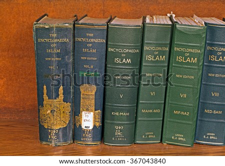 16TH JAN 2016 LIVERPOOL UK Volume of The Encyclopedia of Islam on a library shelf - stock photo