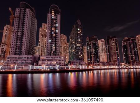 7th January, 2016 - Dubai, UAE: Beautiful nightscape of Dubai Marina lake taken from the JBR 2 lakeside. - stock photo