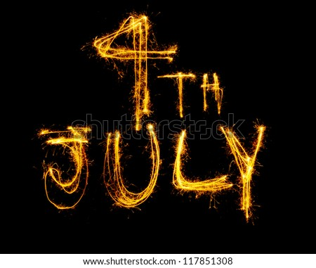 4th July written in sparklers isolated on black - stock photo