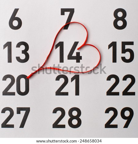 14Th of February calendar reminder with a red satin heart. - stock photo