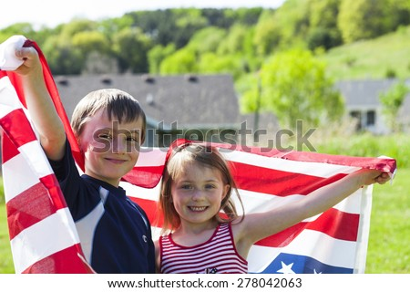 4th of july holiday: cheerful children holding  American flag