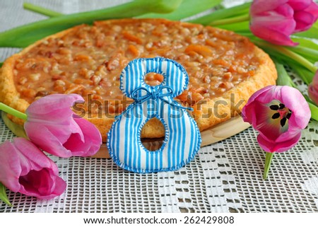 8th of March. Image of delicious caramel tart and tulips - stock photo