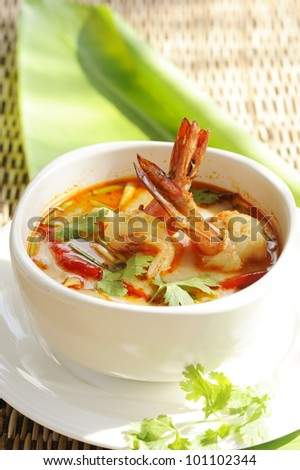 Thai Cuisine - Tom Yum Goong - Thai hot and spicy soup with shrimp - stock photo