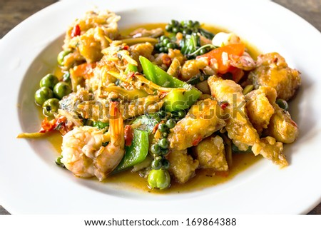 thai curry freshwater fish served on a plate