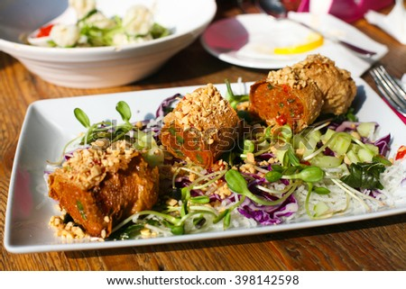 Thai food, a delicious fried fish roll  with salad  - stock photo