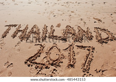 """Thailand 2017"" written in the sand on the beach"