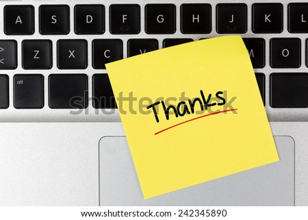 """Thanks"" Note on Laptop - stock photo"