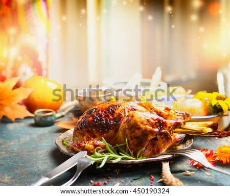 Thanksgiving Day dinner table with roasted  turkey, side view
