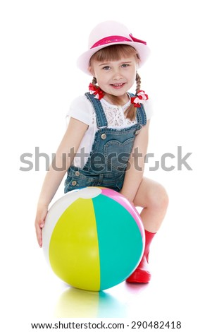 The baby boots and hat with the ball in his hands- isolated on white background - stock photo
