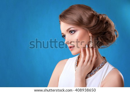 The beauty of the girl . Beautiful woman with mask of cat and professional makeup. Photographed in studio on a blue background. - stock photo