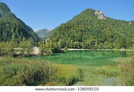 the clear turquoise Lake Jasna near Kranjska Gora in Triglav National Park,Slovenia - stock photo
