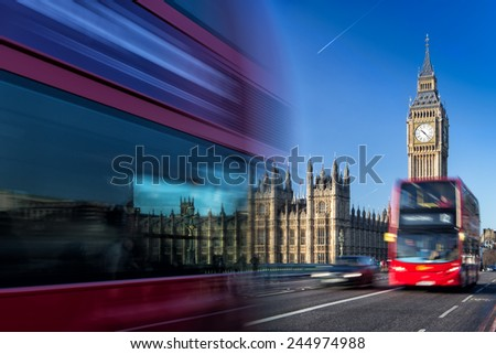 The Clock Tower, named in tribute to Queen Elizabeth II, more popularly known as Big Ben and iconic red buses. - stock photo