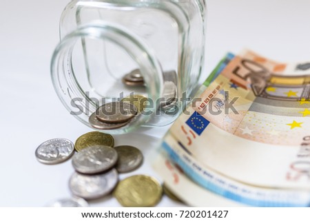 The concept of saving money. Saving money coin and paper in bottle. Saving euro money in glass jar isolated on white background
