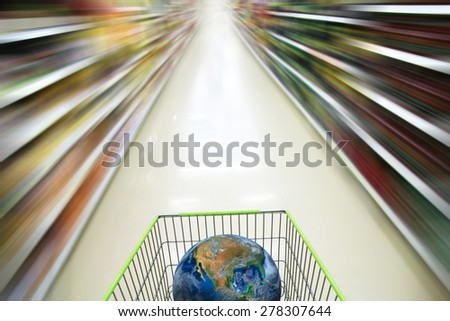 the earth on supermarket cart, including elements furnished by NASA - stock photo