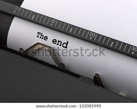 """The end"" message typed by vintage typewriter. - stock photo"