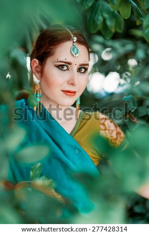 The european girl in the blue Indian costume. - stock photo