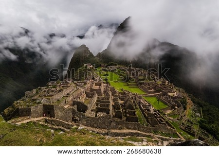 the foggy ruins of machu picchu - stock photo