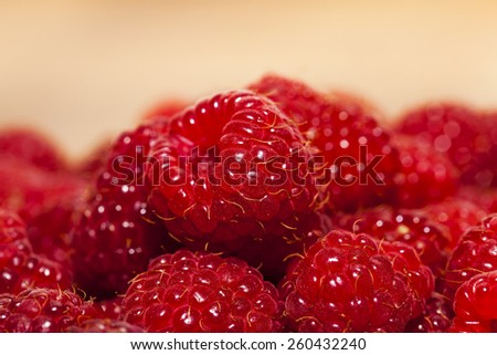the gathered and piled raspberry. small depth of sharpness - stock photo