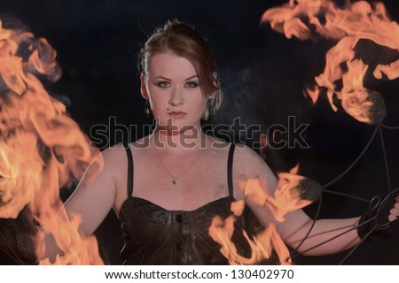 The girl acts with fire - stock photo