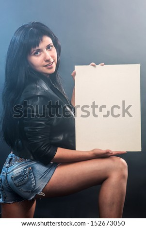 The girl holds the pure form - stock photo