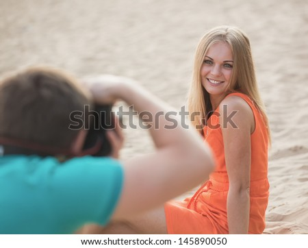 The girl poses before the photographer - stock photo