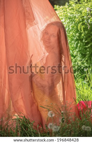 The girl under a fabric - stock photo