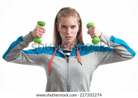 The girl with dumbbells on a white background - stock photo