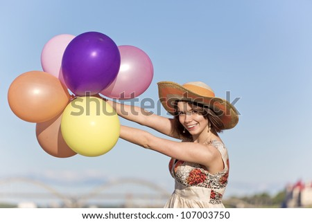 The girl with multi-coloured spheres - stock photo