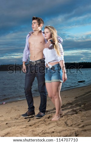 The guy and the girl go on a beach