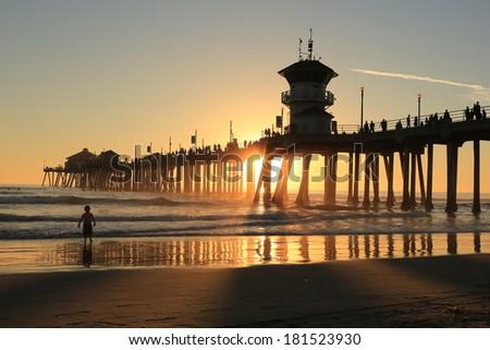 the Huntington Beach pier under sunset  - stock photo