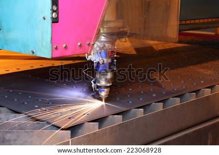 The laser cutting installation, CNC-controlled machine concept, Laser cutting heads for vertical cutting sheets metal. - stock photo