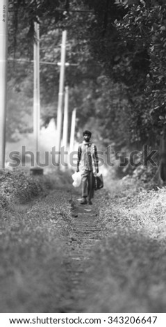 """The Lone Traveller"" :  Clicked in Calcutta,India in the early hours of the day, this photograph depicts a sole traveler from South India."
